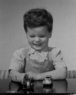 Child with Toy Cars publicity shot for Young Wives' Tale