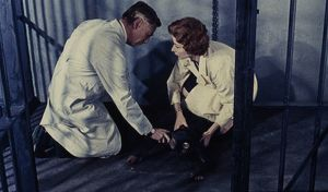 Dr Decker and Margaret in the empty cage