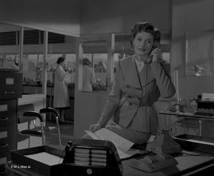 Helen Cherry on the phone in a scene from Young Wives' Tale (1951)