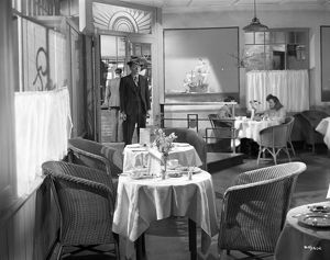 Pinkie enters the restaurant where Rose works in Brighton Rock (1947)