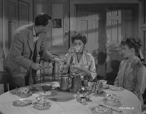 A production still image from Young Wives' Tale (1951) set at the breakfast table
