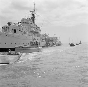 A Royal Navy ship and small boats