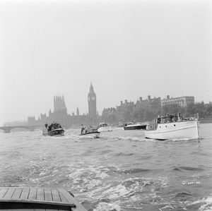 Small boats on the Thames with The Houses of Parliament in the background