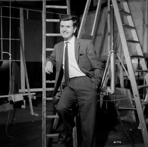 A smiling Rodney Bewes on the set of Billy Liar (1963)