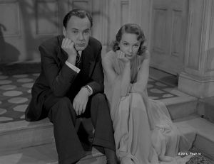 Thoughtful Derek Farr and Joan Greenwood in a scene from Young Wives' Tale